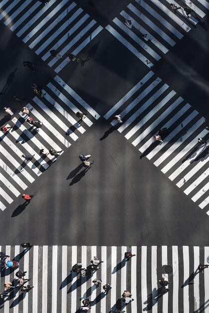 A big pedestrian crossing which is not very crowded