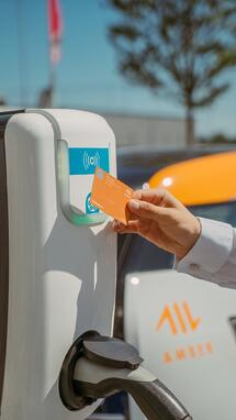 A man paying contactless for powering his electric car