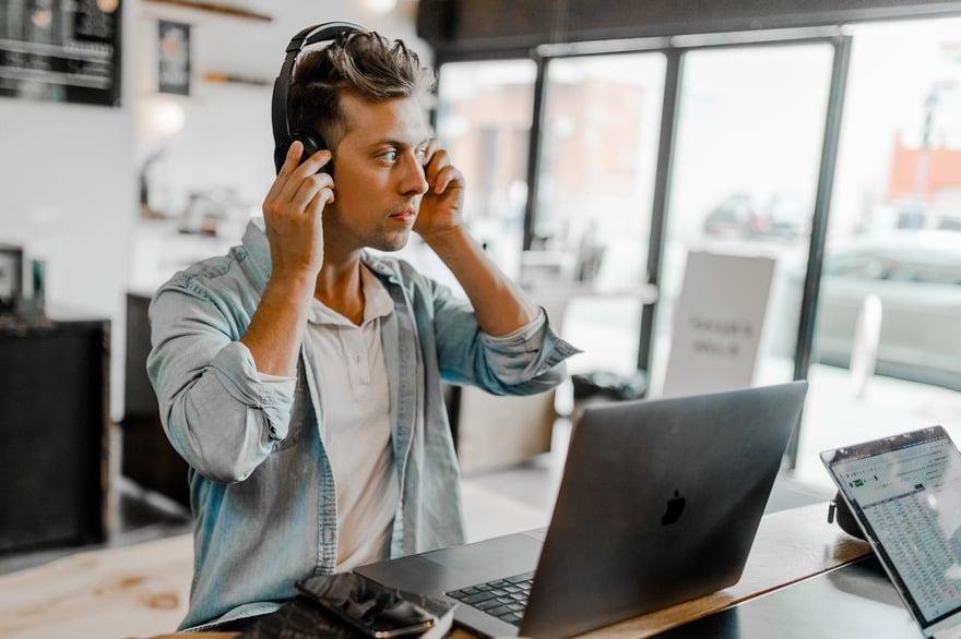man-standing-desk-laptop-flip