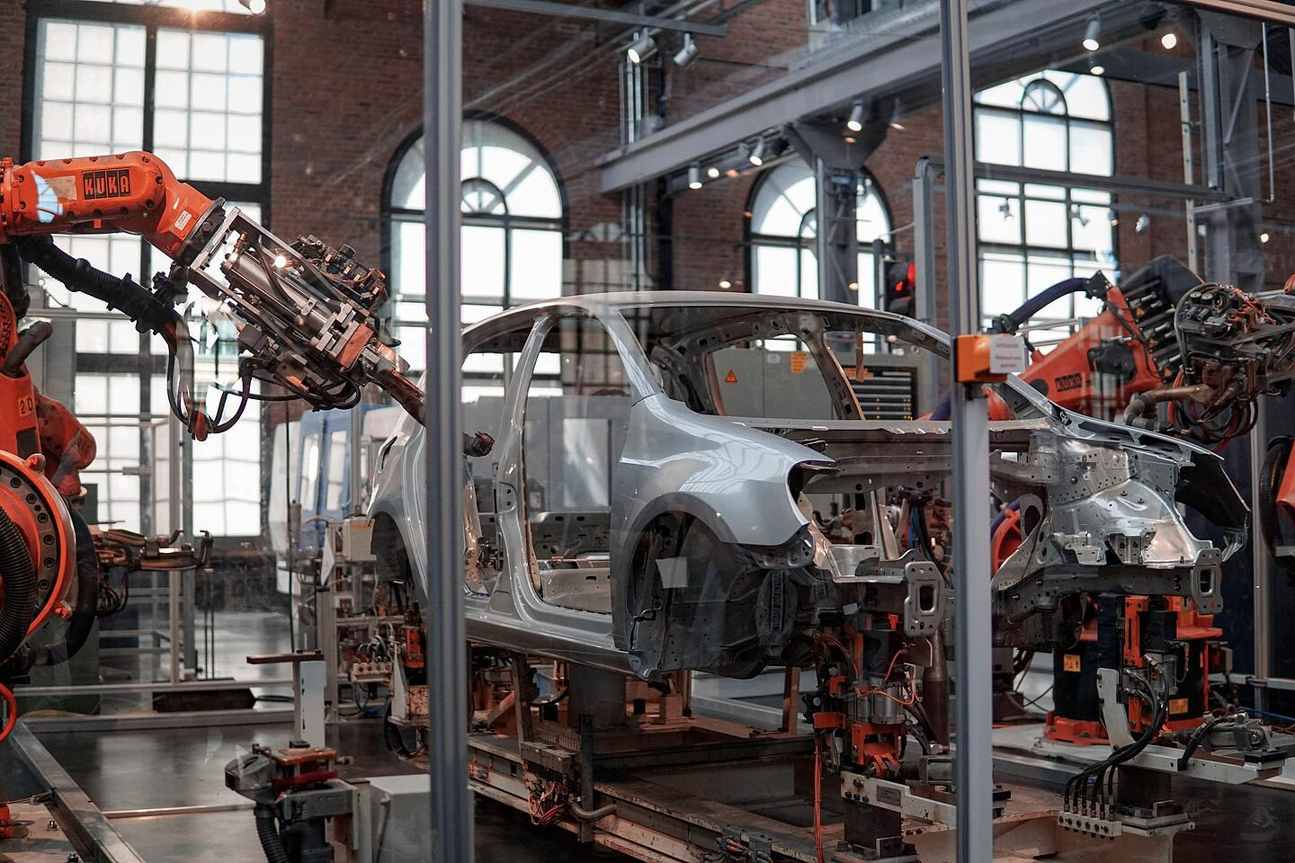 A car manufacturing robot in an industrial environment