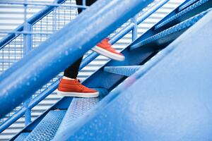 red-shoes-walking-up-blue-stairs